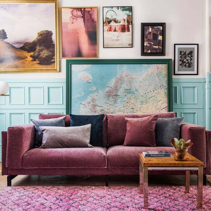 16602553_10154886655291827_7378471443532006336_o purple couch cover living room gallery wall