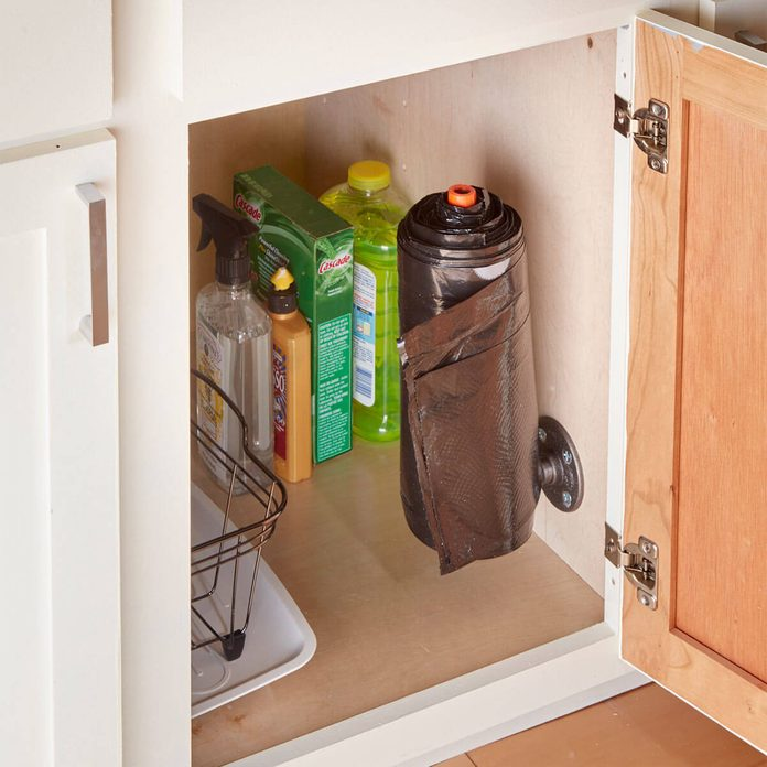 pipe trash bag dispenser with roll of trash bags