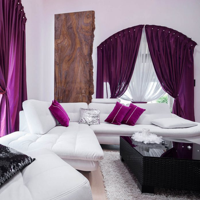 shutterstock_321707927 purple curtains window treatments white living room