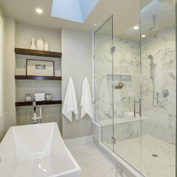 shutterstock_555797377 step in shower bathroom