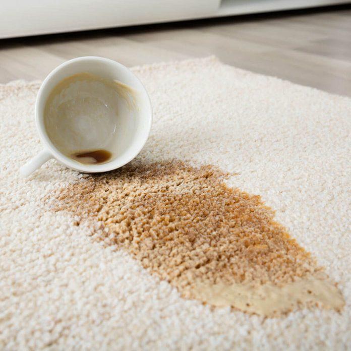 shutterstock_561916813 spilt coffee on carpet