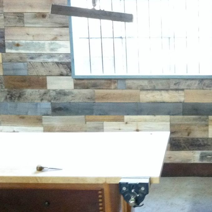 salvaged pallet shop wall