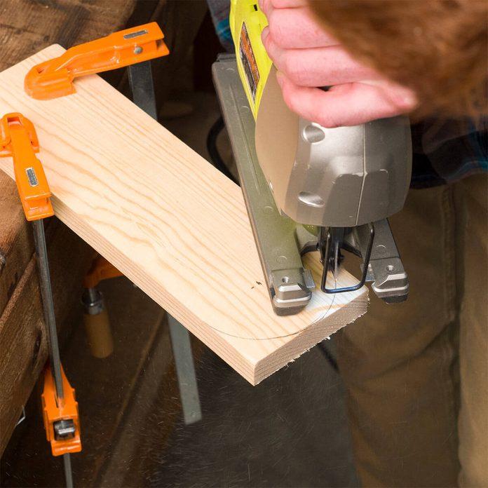 cutting arcs in cornhole board legs
