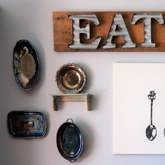 metal plates and platters eat sign