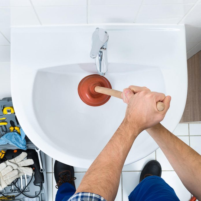bathroom sink drain clogged plunger