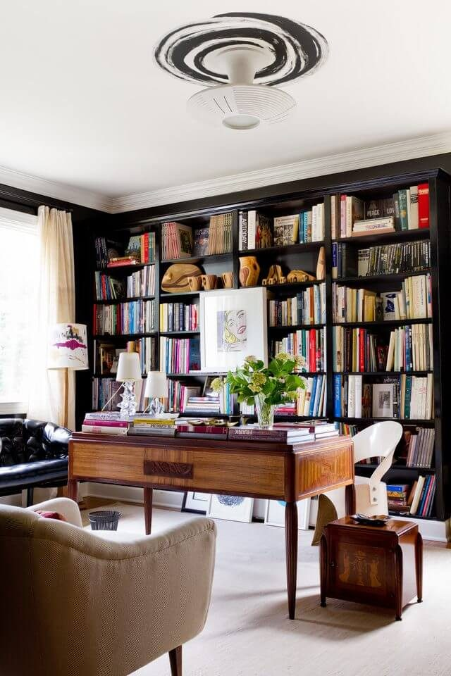 floor-to-ceiling bookcase with wood desk