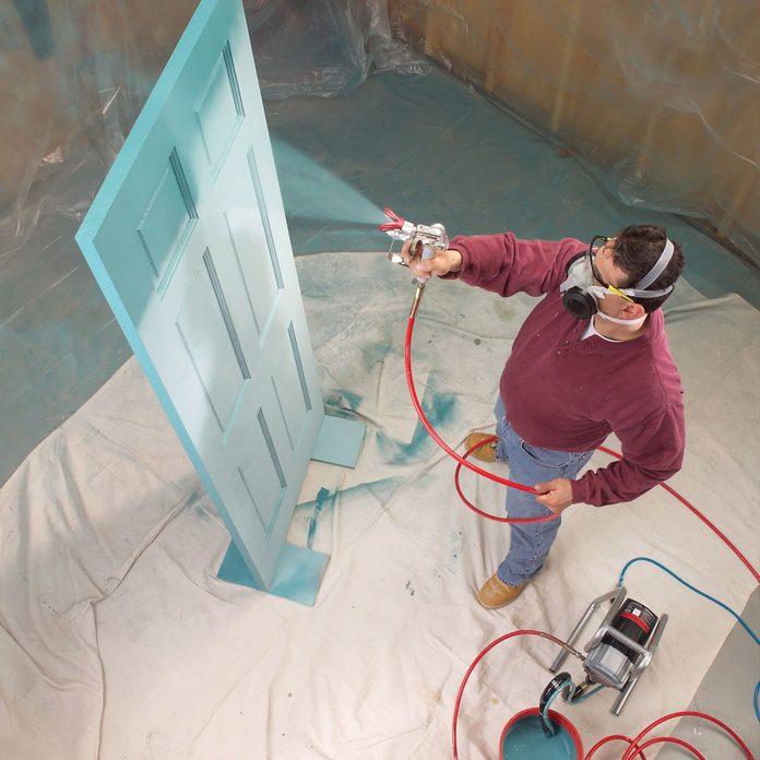 paint door with airless sprayer