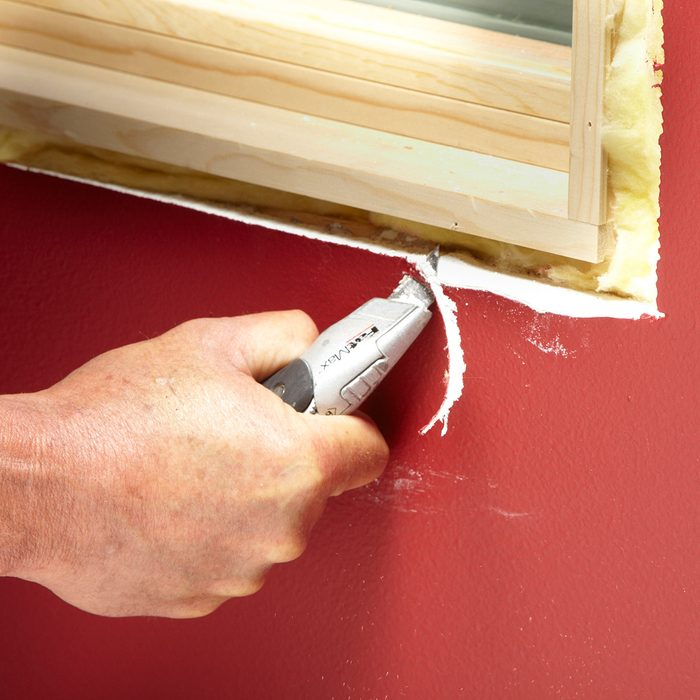 Cutting away drywall for better trim fits | Construction Pro Tips