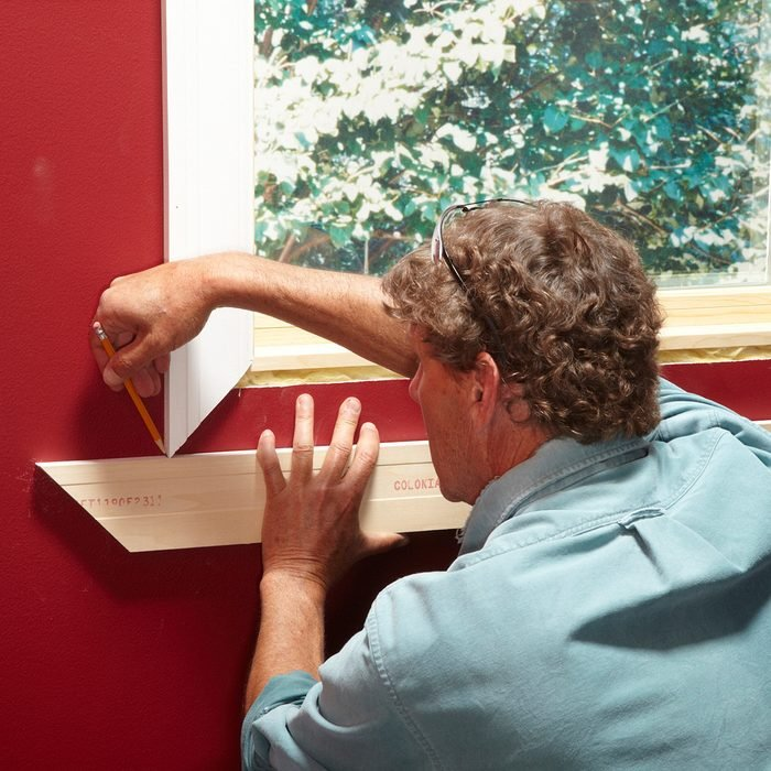 Scribing the miter for a perfect fit | Construction Pro Tips