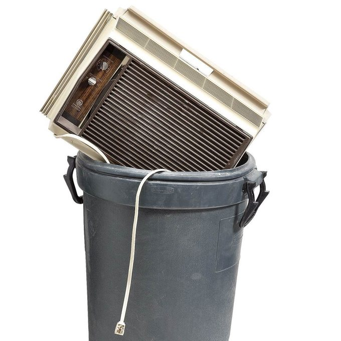 room air conditioner in trash can