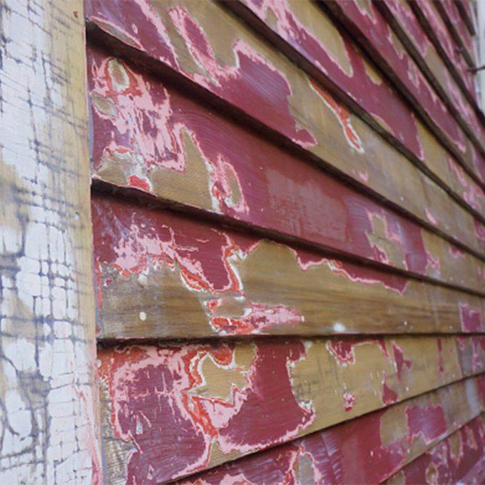 peeling paint up close on house