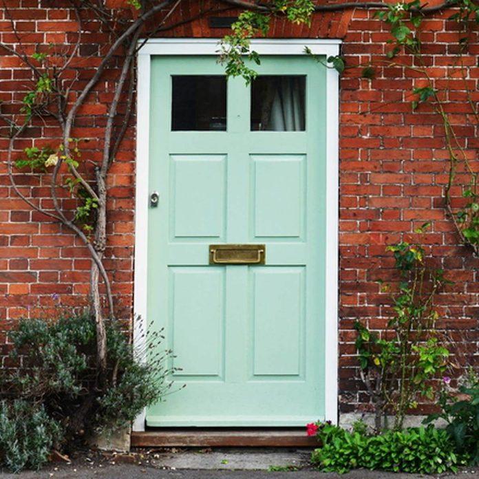 Mint Green Front Door with Brick