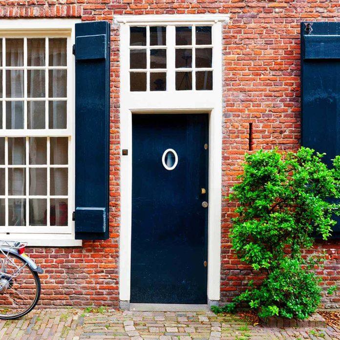 Dark Blue Front Door with Matching Shutters Brick siding