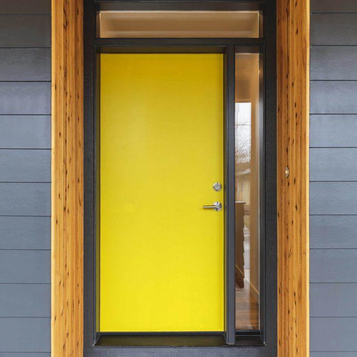 Yellow Front Door with Wood Trim