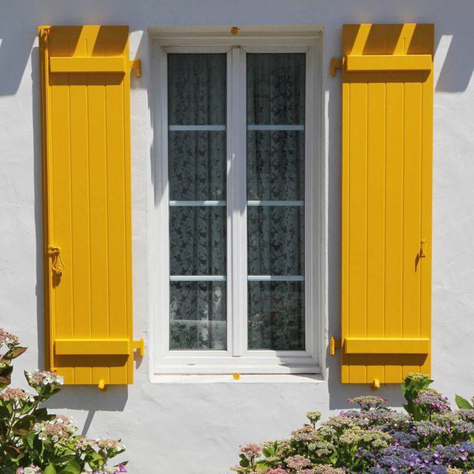 yellow window shutters