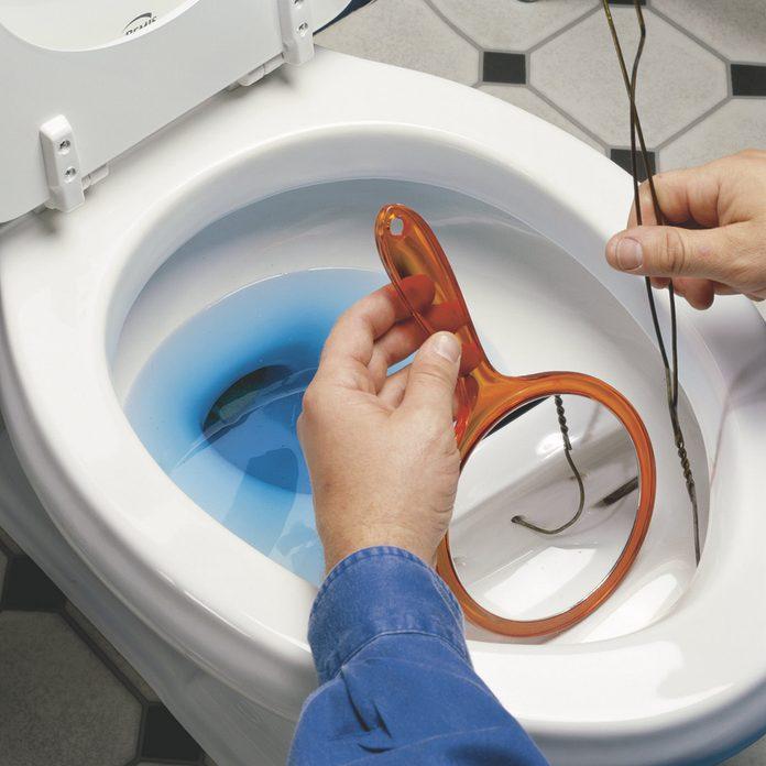 unclog toilet fill holes