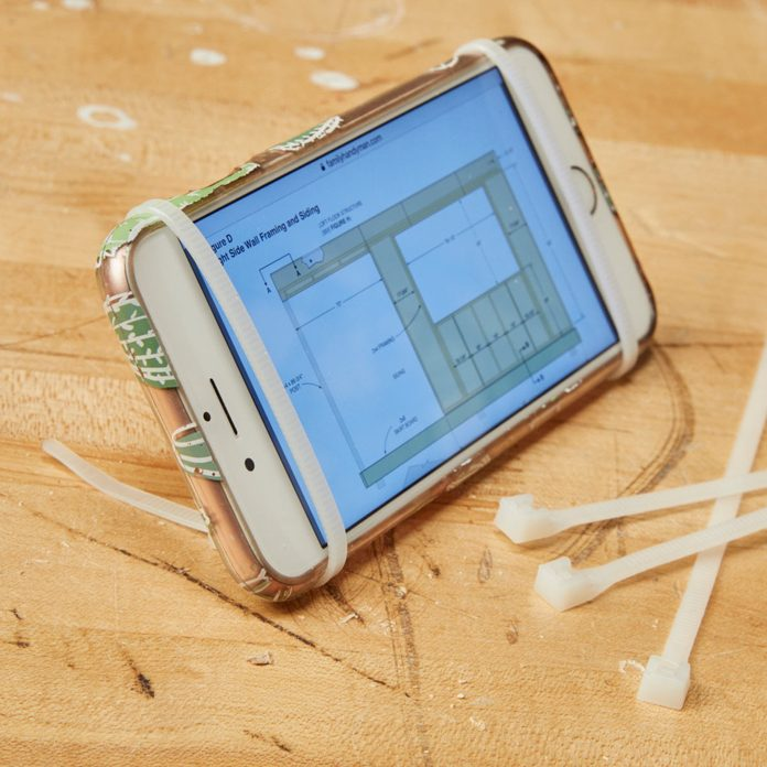 HH zip-tie phone stand propped up