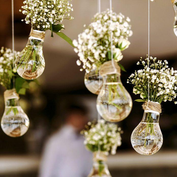 whimsical hanging lightbulb flowers wedding