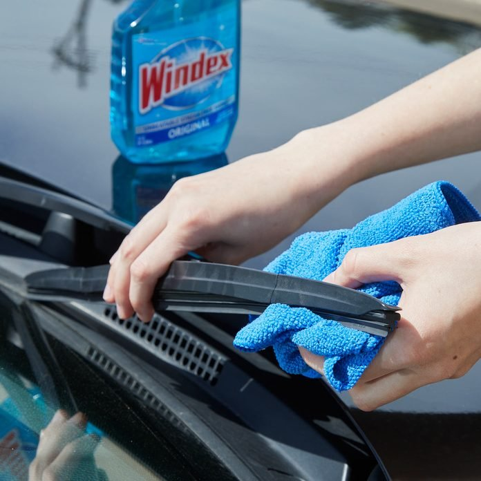 HH clean windshield wipers with windex
