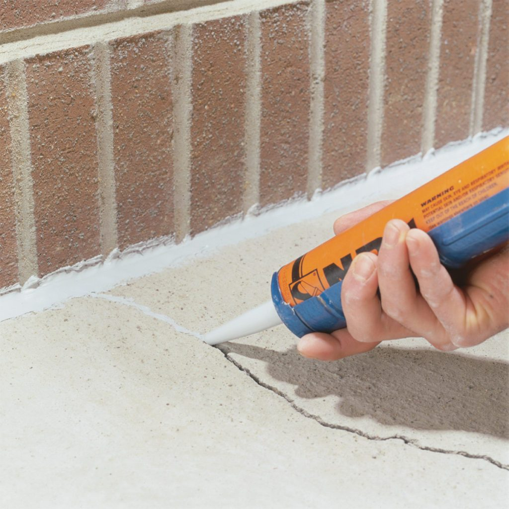Sealing cracks in concrete with sealant   Construction Pro Tips