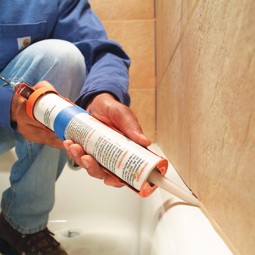 Caulking the tile seam in a bathtub   Construction Pro Tips