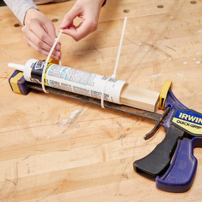 HH improvised caulk gun clamp zip-ties