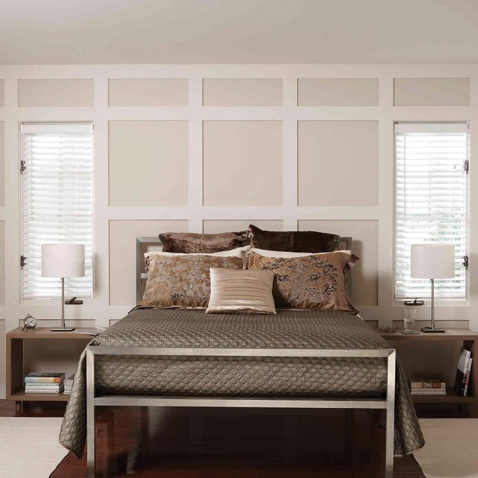 after bedroom makeover paneled wall