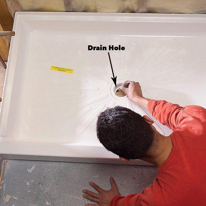 Mark the new drain hole shower install