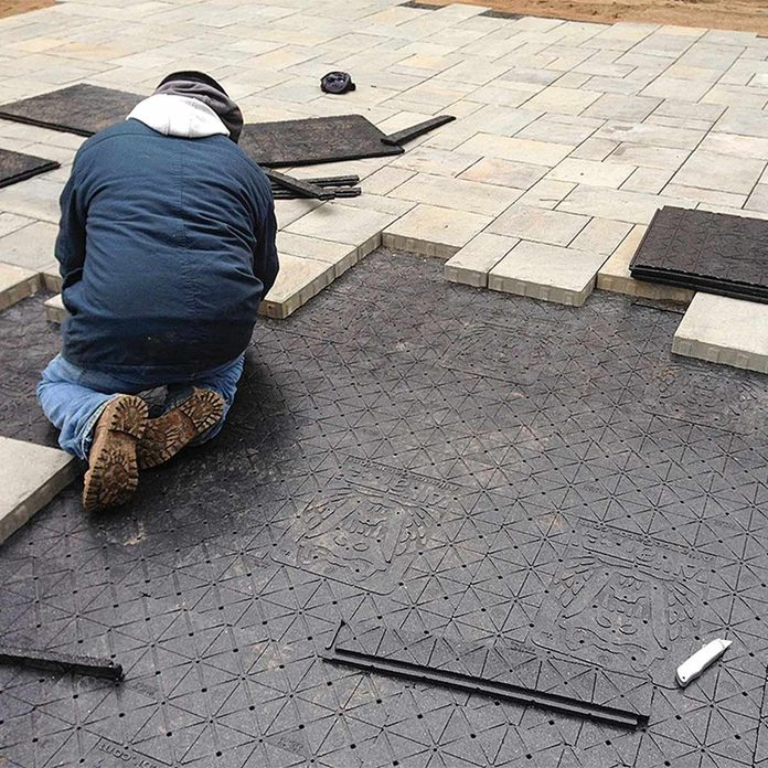 install pavers over panels patio