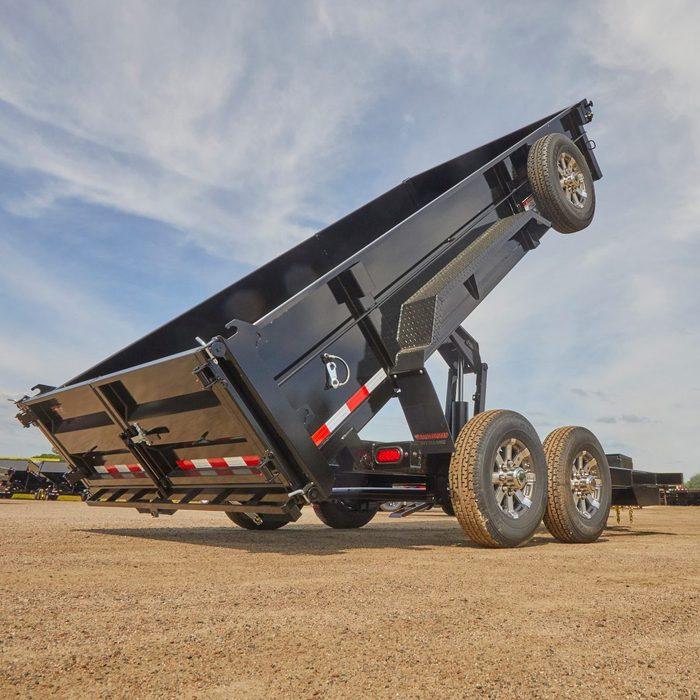 Black Dump Trailer in Dump Position   Construction Pro Tips