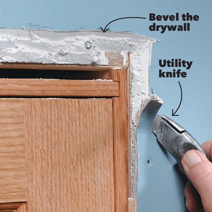 slice the drywall trim a door