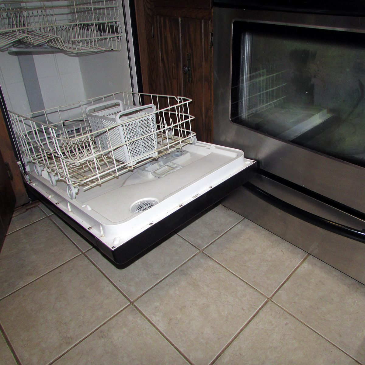 A dishwasher opened and blocking an oven   Construction Pro Tips