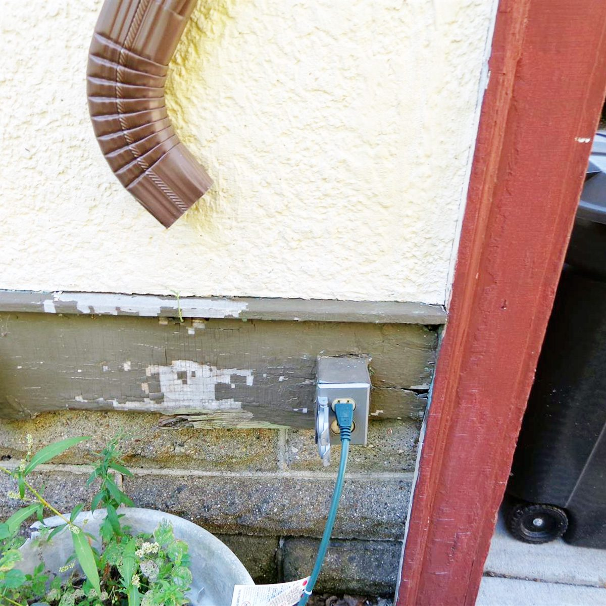 A downspout pointed directly at an outlet   Construction Pro Tips