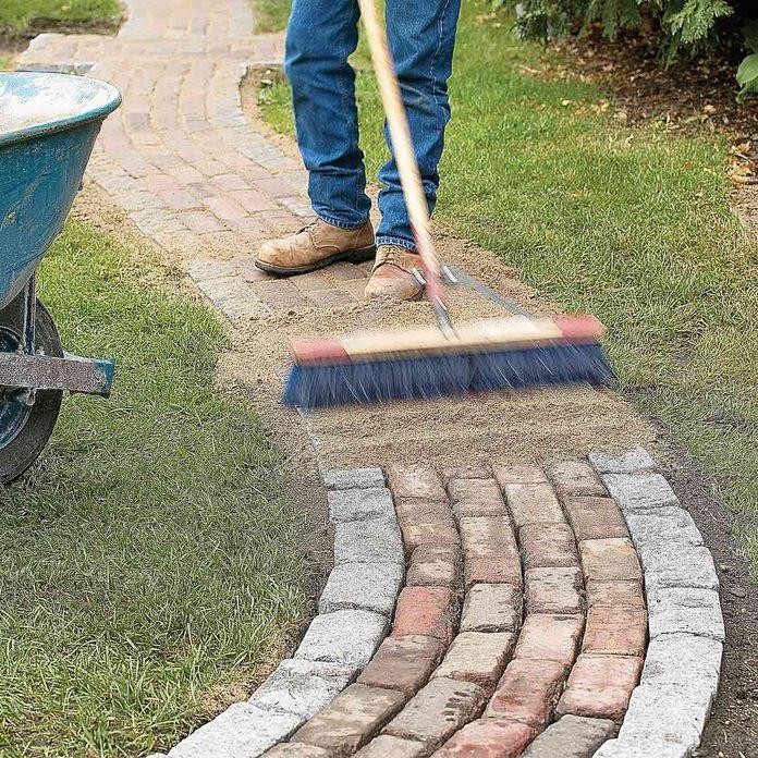 work sand into path gaps