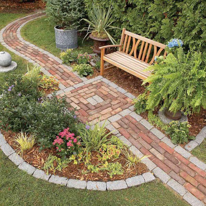 garden brick path and bench