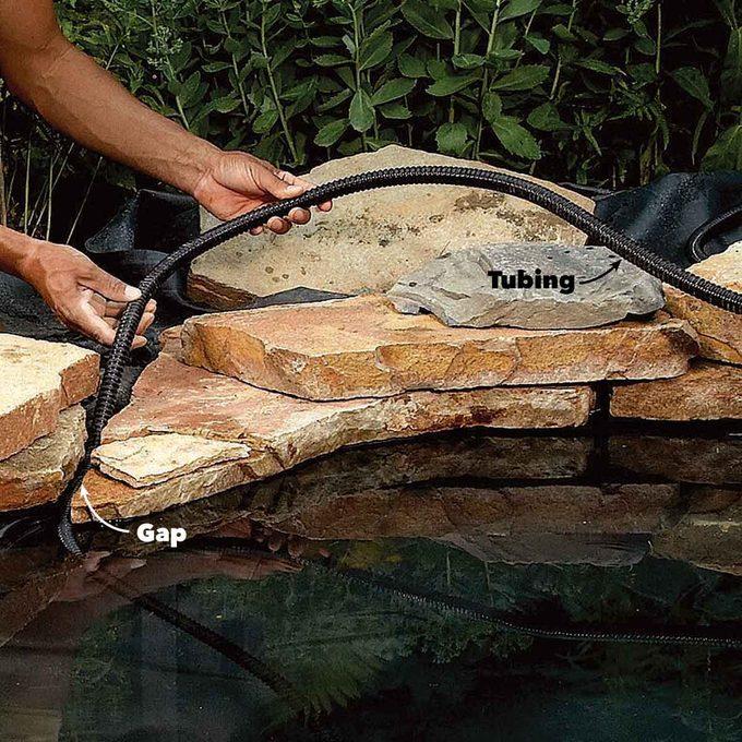 backyard fish pond plumbing tube