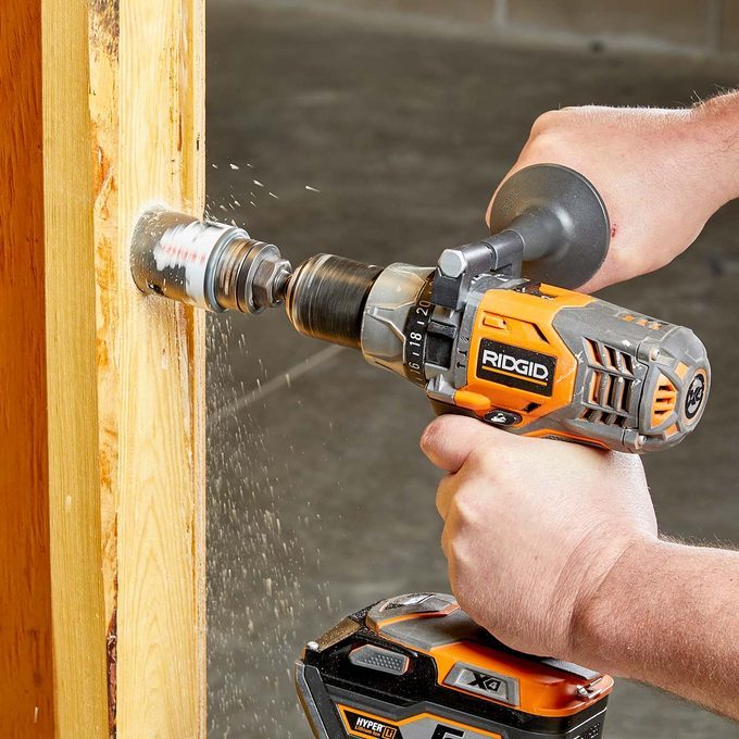 rock the drill with hole saw bit