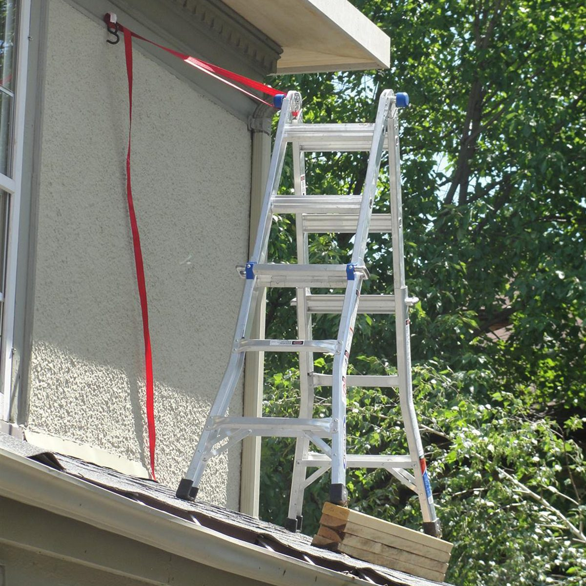 A ladder strapped up to the side of the house   Construction Pro Tips