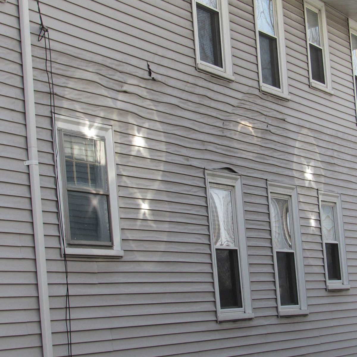 Melted siding on the side of a house   Construction Pro Tips