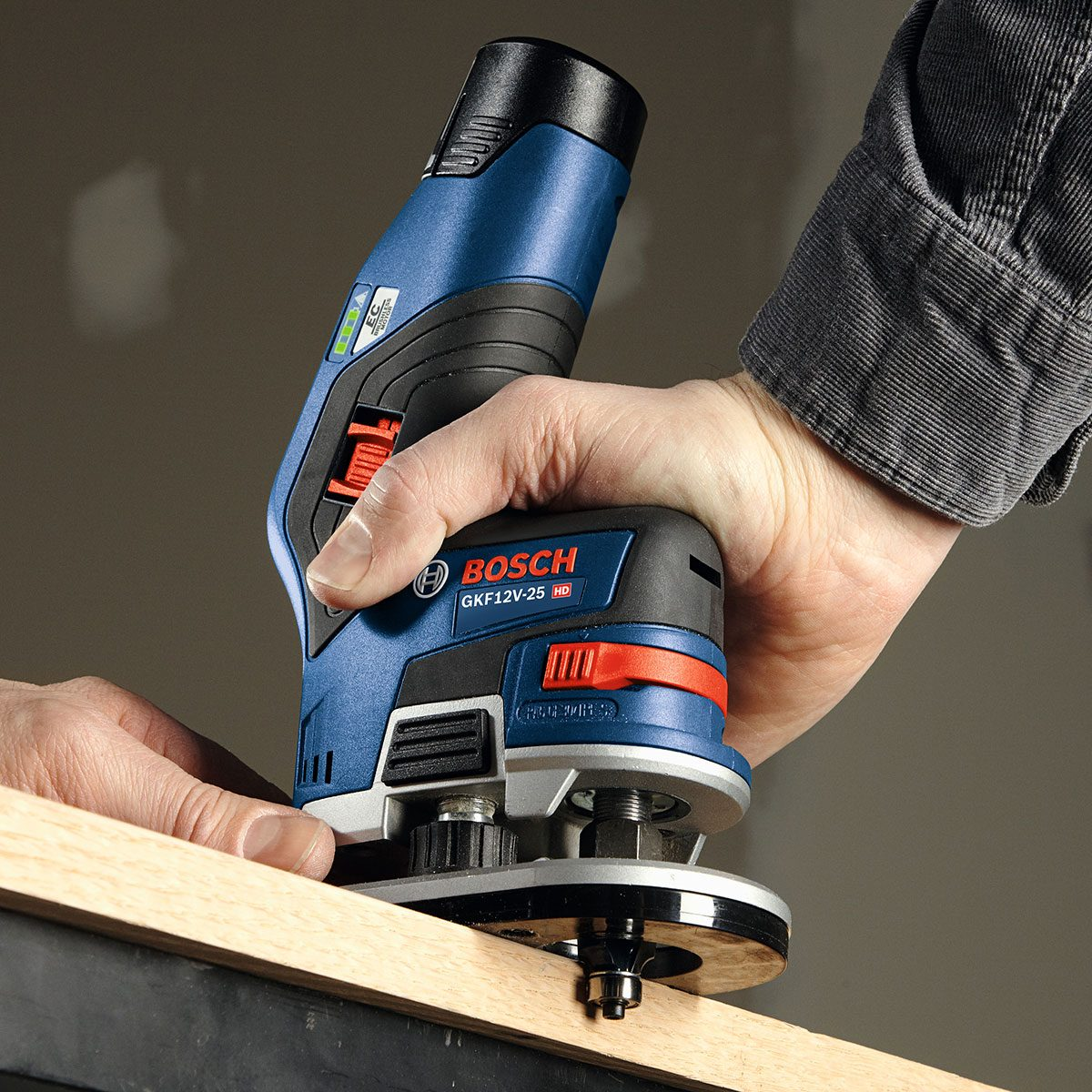 Man Holding a Bosch Router | Construction Pro Tips