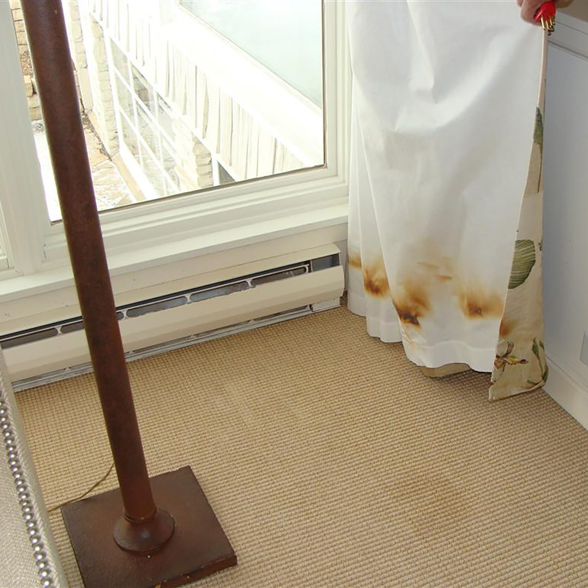 Singed curtains sitting too close to heater   Construction Pro Tips