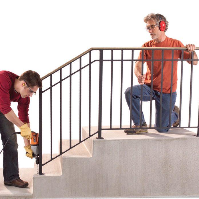installing iron handrail exterior steps
