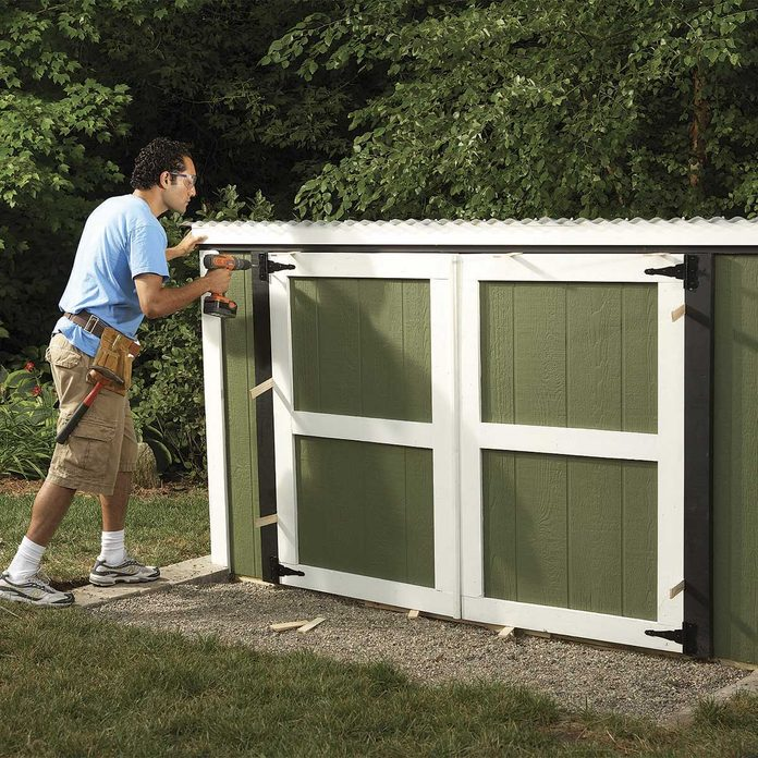 build lawn mower shed - doors and paint