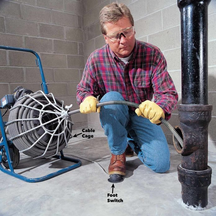 feed in the drain cleaning cable