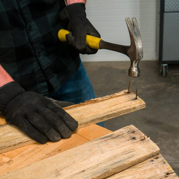 pallet side table remove nails and make rough cuts