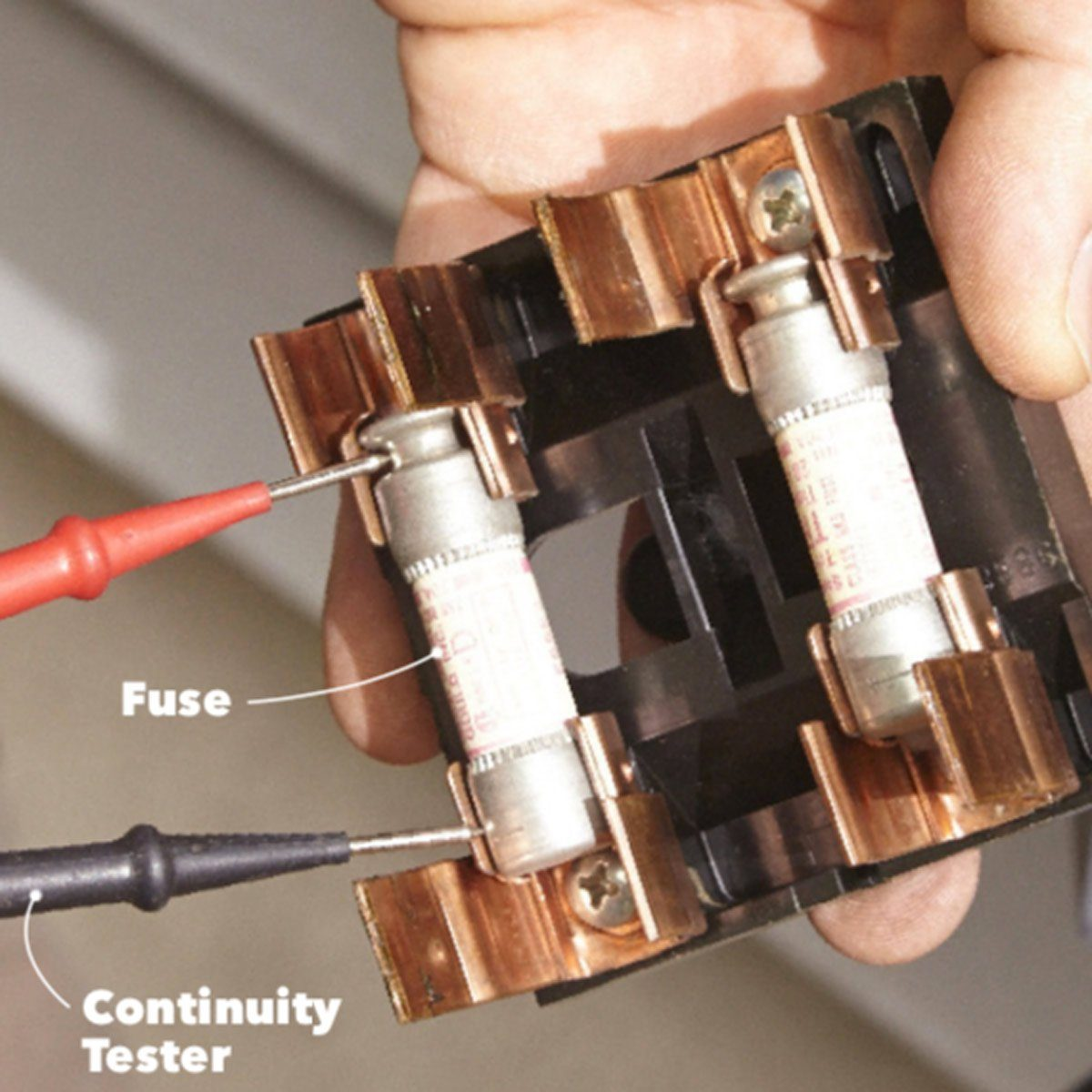 Checking to see if fuses are burnt out with continuity tester   Construction Pro Tips