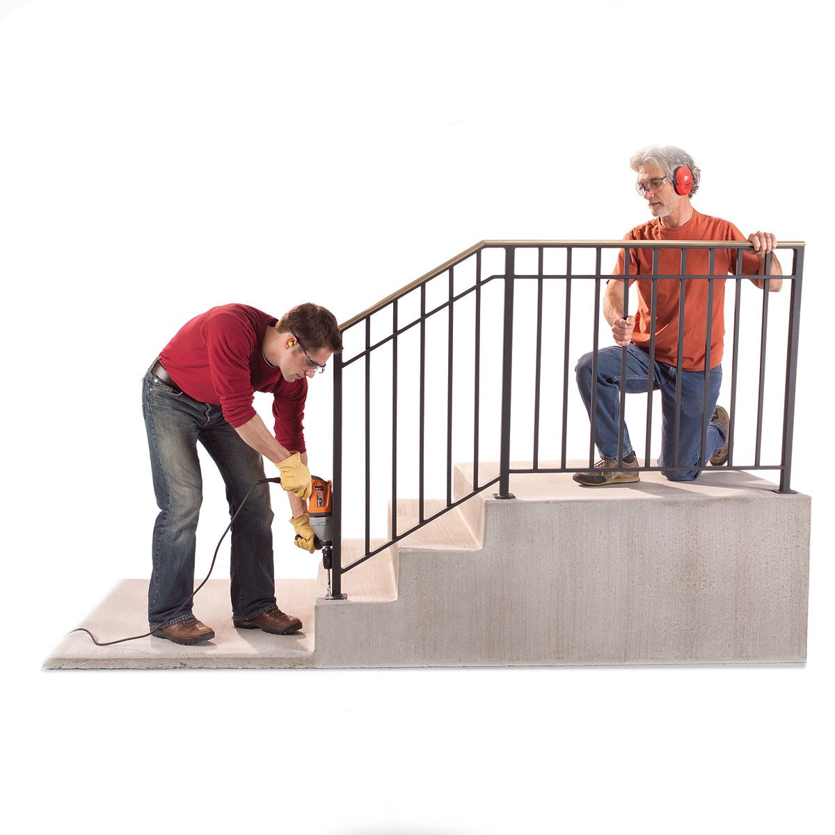 Two men installing a sturdy handrail   Construction Pro Tips