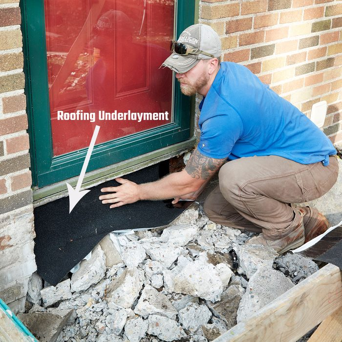 Placing underlayment to protect house | Construction Pro Tips