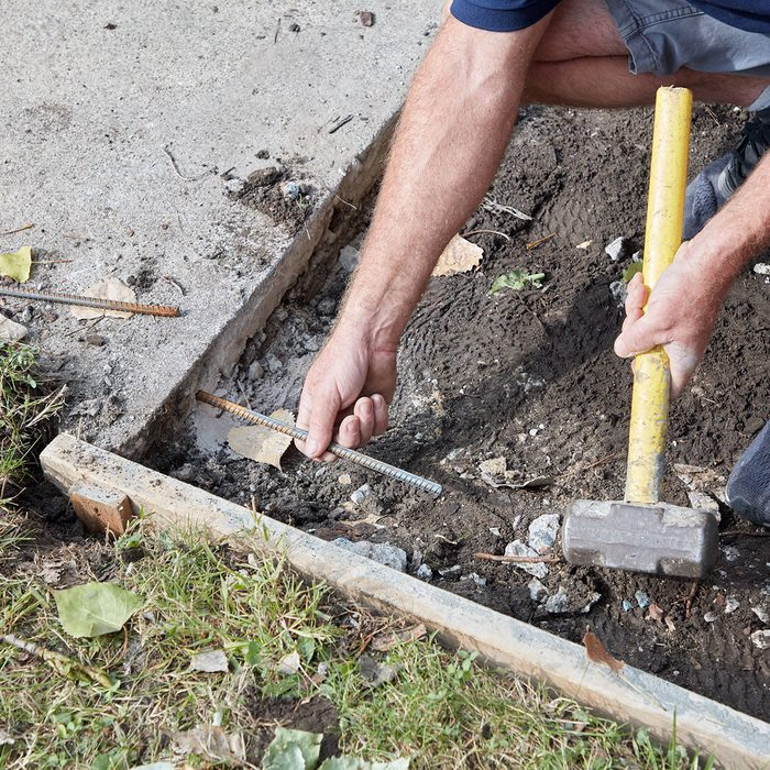Tying into the existing sidewalk with rebar | Construction Pro Tips