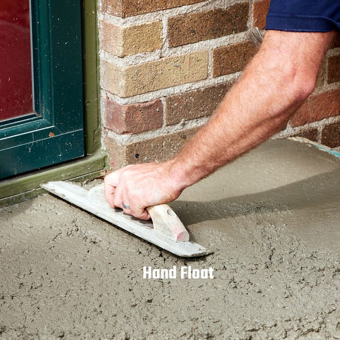 Smoothing concrete surface with hand float | Construction Pro Tips